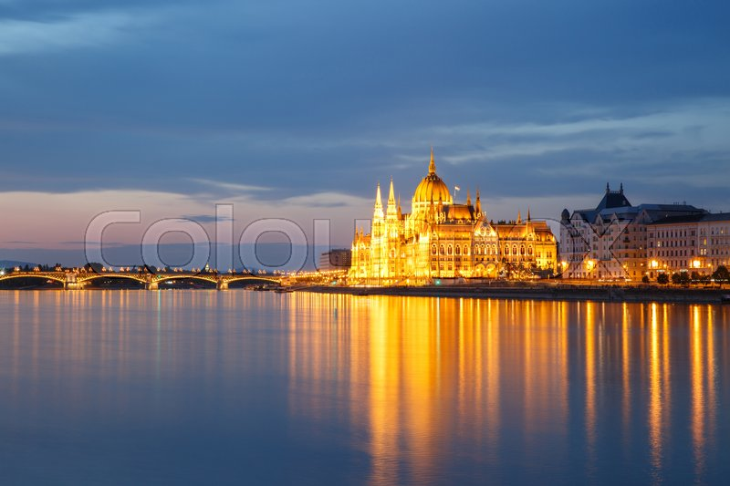 Stock image of 'View of Budapest with the Parliament building and Margaret Bridge at sunset. Hungary '