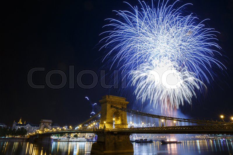 Stock image of 'Fireworks in Budapest. View of the illuminated Chain Bridge and the Danube River. Hungary '