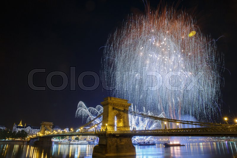 Stock image of 'Fireworks over the Danube in Budapest. View of the illuminated Chain Bridge. Hungary '