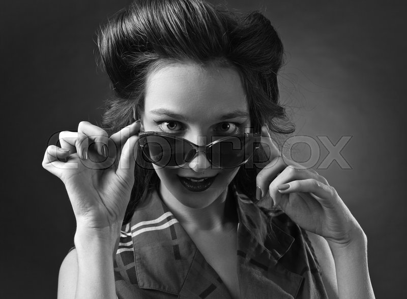 Stock image of 'Black and white portrait of a young beautiful woman with sunglasses , studio shot'