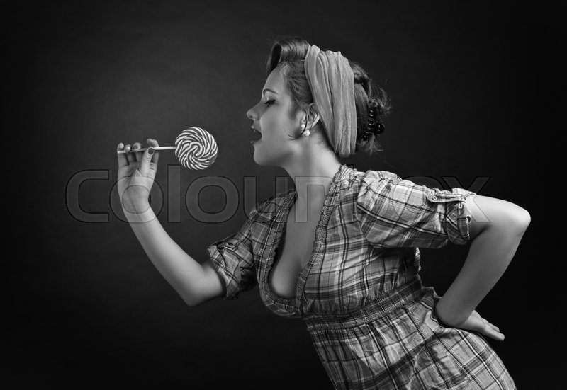 Stock image of 'Black and white portrait of a young beautiful woman  with Lollipop , studio shot'