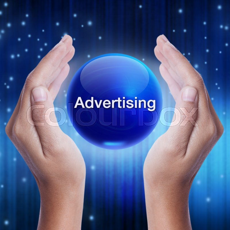 Stock image of 'Hand showing blue crystal ball with advertising word. business concept'