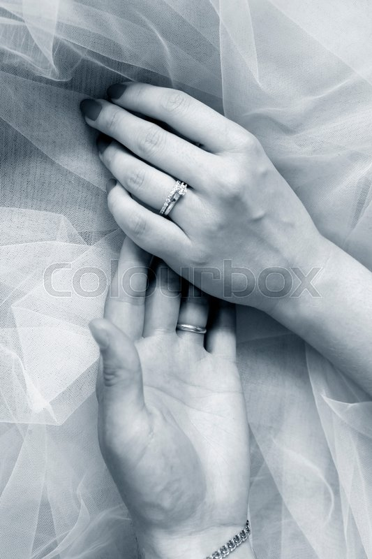 Stock image of 'The groom keep the bride for hands. '