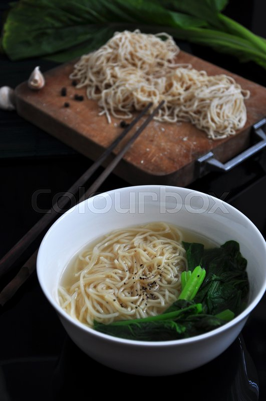Stock image of 'Bowl of egg noodle with fresh ingredients on background'