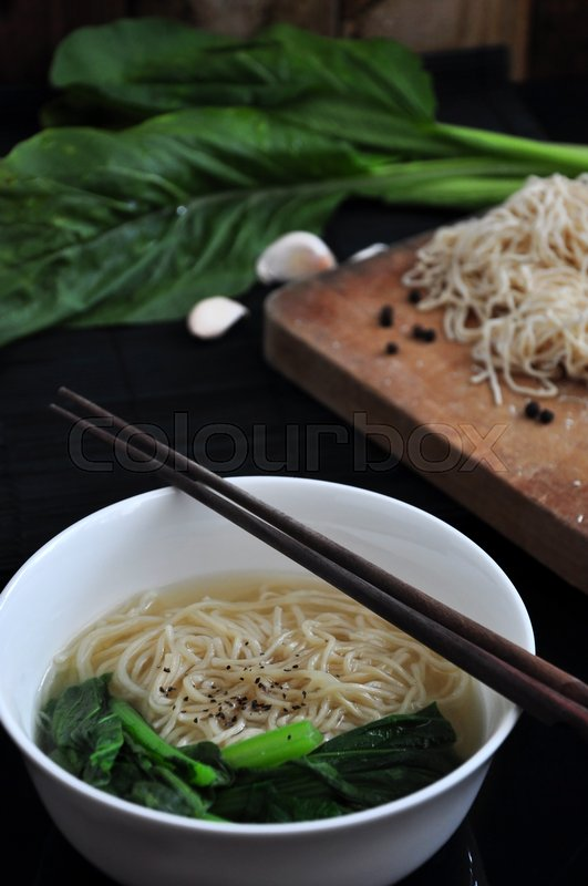 Stock image of 'Close up egg noodle bowl with fresh ingredients on background'