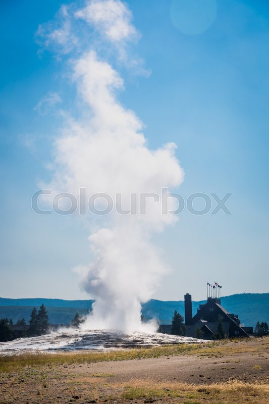 Stock image of 'Old Faithful Geyser Erupting at Yellowstone National Park.'
