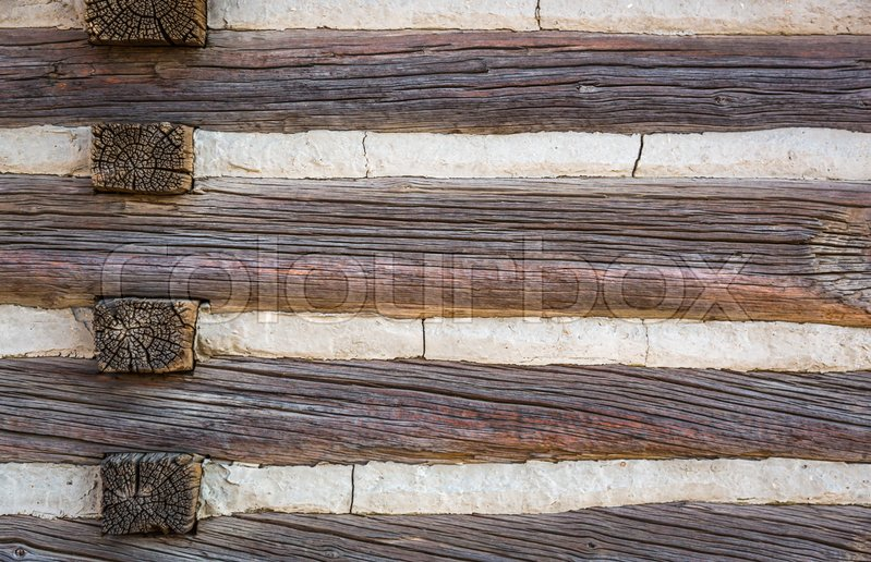 Stock image of 'Abstract of Vintage Antique Log Cabin Wall.'