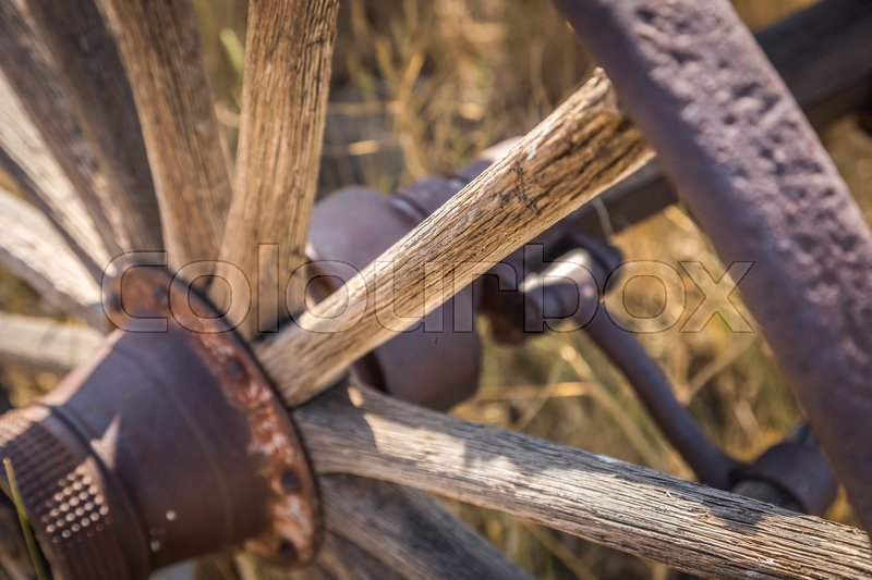 Stock image of 'Abstract of Vintage Antique Wood Wagon Wheel.'
