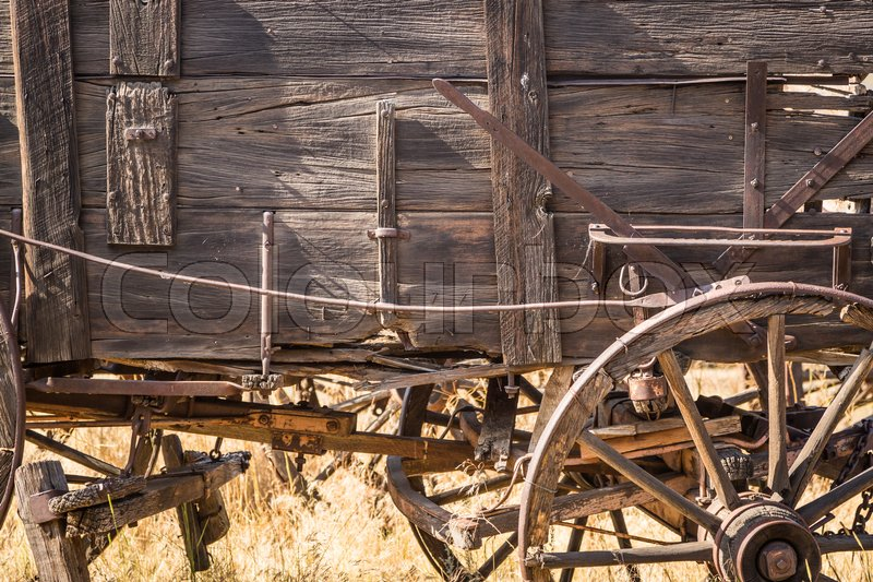 Stock image of 'Abstract of Vintage Antique Wood Wagons and Wheels.'