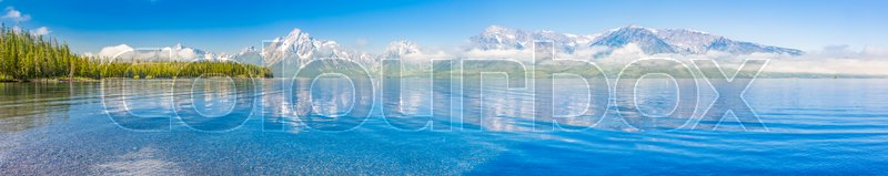 Stock image of 'Pano of The Grand Teton National Park Mountain Range in Wyoming, USA.'
