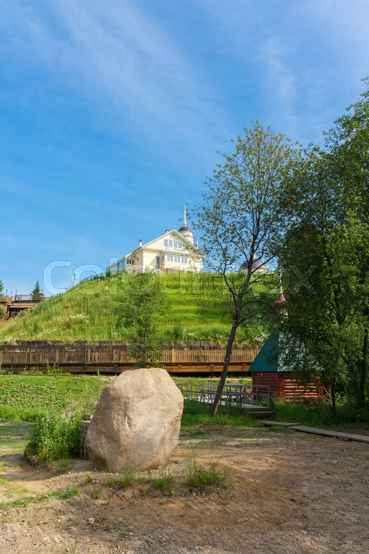 Stock image of 'Sacred stone on the background of the church, Radonezh, font, Golden Ring, Russia'