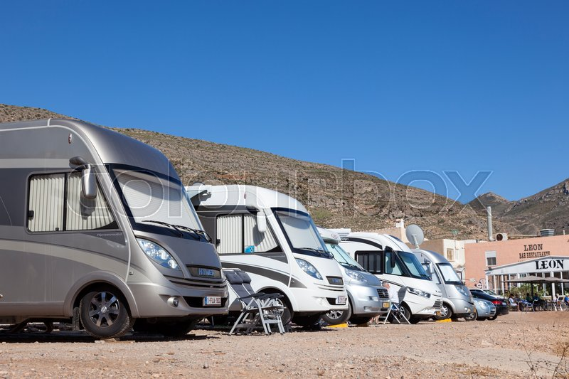 Stock image of 'Azohia, Spain - May 14, 2017: Luxury mobile homes parked at the mediterranean coast in town La Azohia. Province of Murcia, Spain'