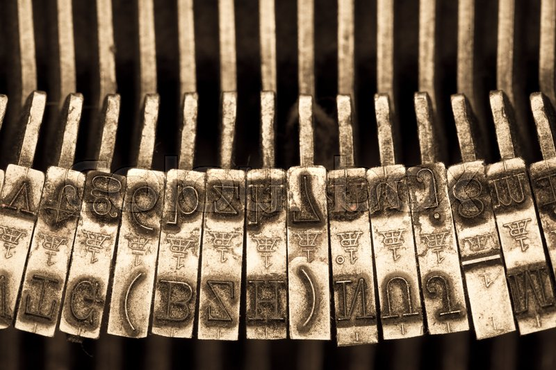 Stock image of 'Closeup of the letters of a vintage mechanical typewriter'