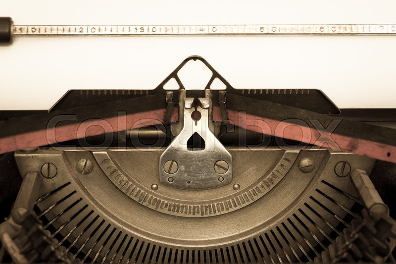 Stock image of 'Closeup of a vintage old typewriter with a sheet of paper. Copy space for your text'