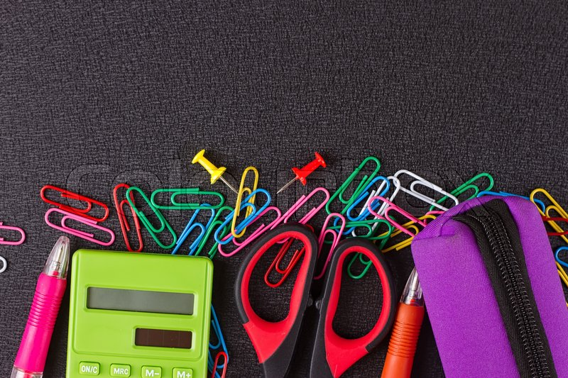 Stock image of 'Frame of stationery on a black background'