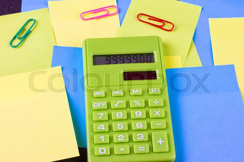 Stock image of 'Multi-colored pasted stickers and green calculator'