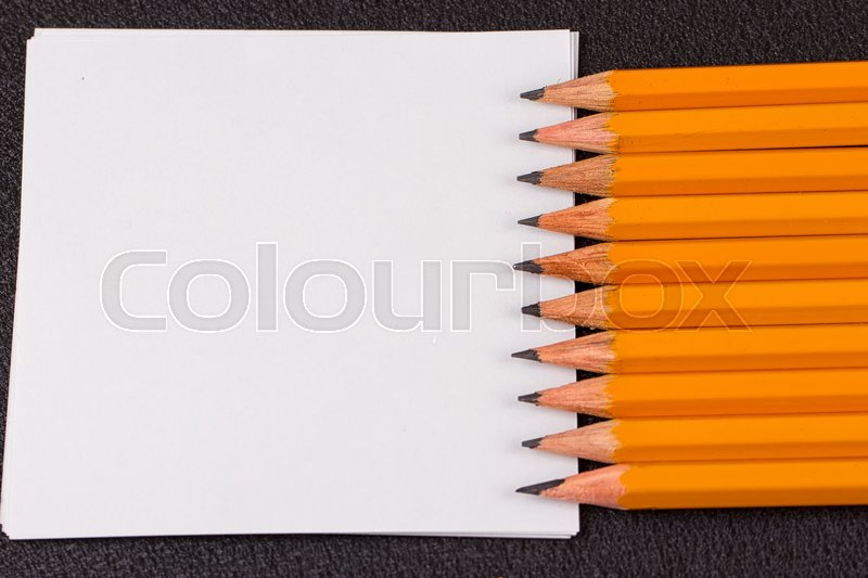 Stock image of 'Simple pencils, a blank sheet, a template'