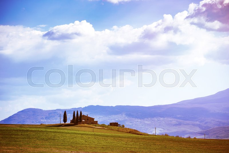Stock image of 'tuscany landscape with old house and cypresses at sunny day.  province of Siena. Tuscany, Italy  '