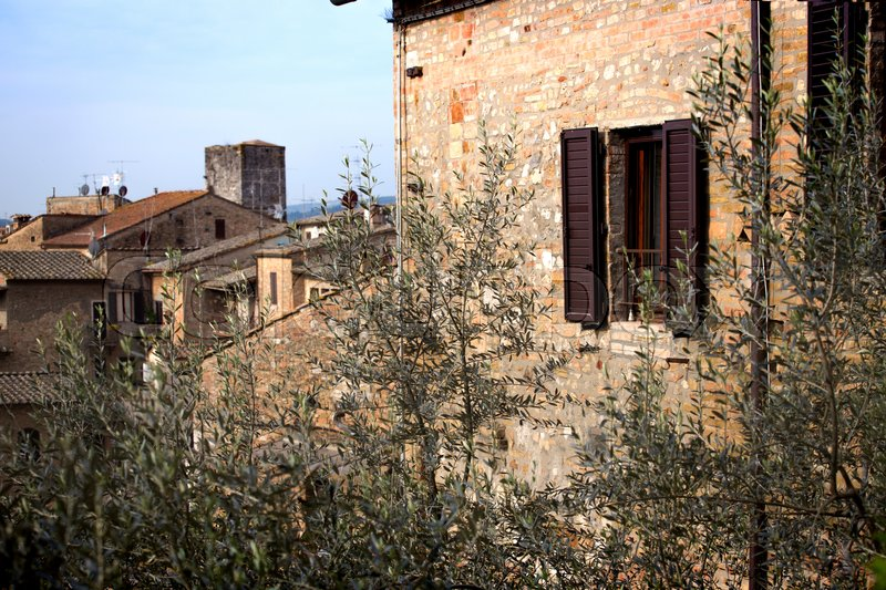 Stock image of 'The facade of an old Italian house at the San Gimignano Tuscany, Italy '