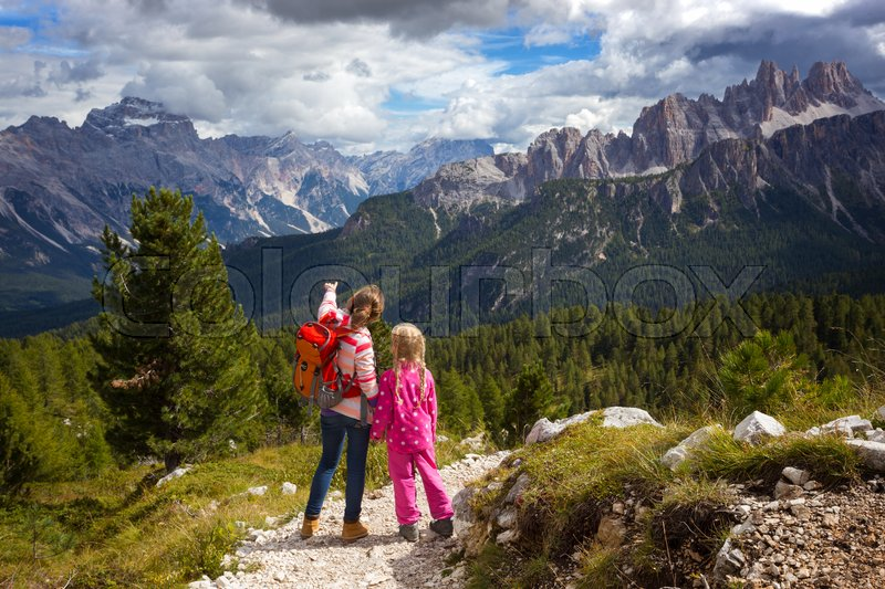 Stock image of 'two sisters girls hikers at the mountains Dolomites, Italy. Cinque Torri '