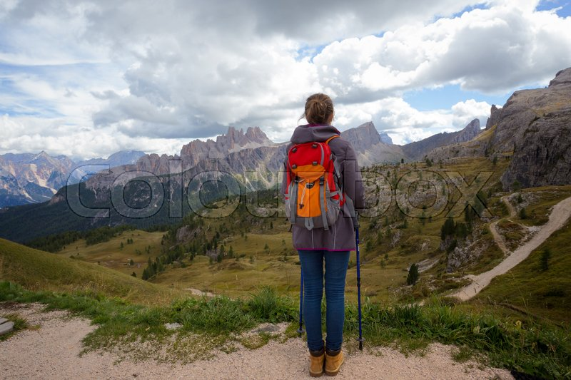 Stock image of 'girl hiker at the mountains Dolomites, Italy. Cinque Torri '