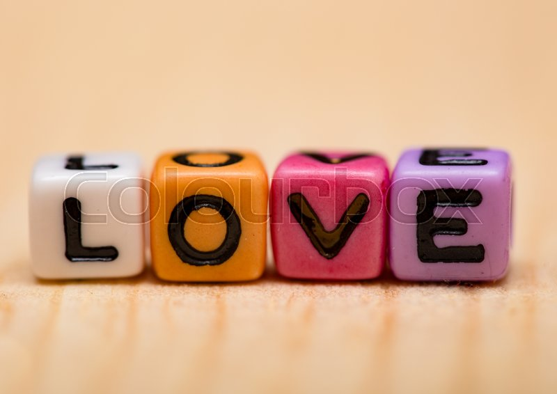Stock image of 'word love from cubes on a wooden desk '