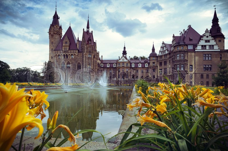 Editorial image of 'Zamek w Mosznej. Moszna Castle - Beautiful castle and lilies in the foreground '