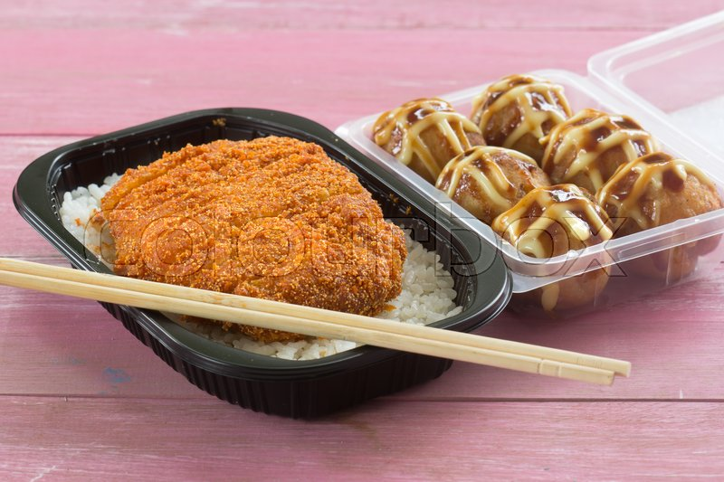 Stock image of 'fried pork topped on rice (tonkatsu)  and Tako Yaki on Box  Japanese food'