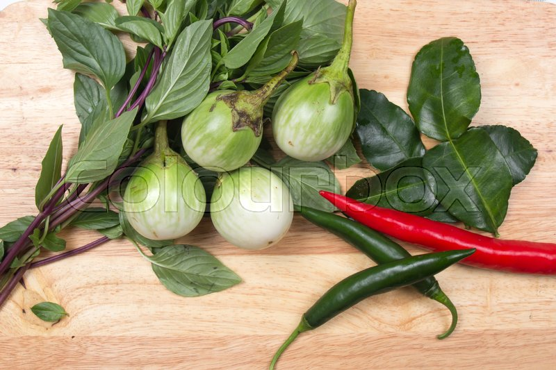 Stock image of 'Ingredients for cooking Green curry / red and hreen chili, eggplant, sweet basil and kaffir lime / cooking green curry concept'