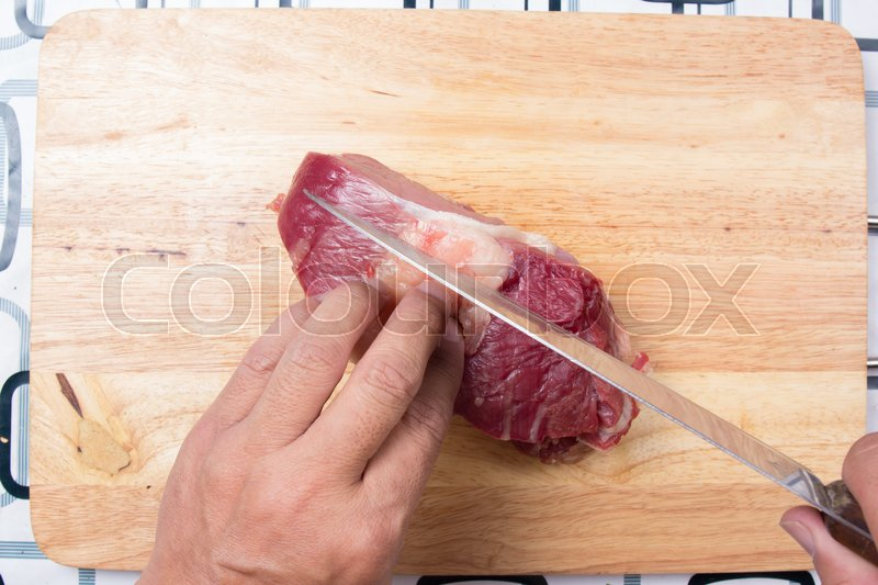 Stock image of 'Chef cutting beef before cooking / Cooking green curry concept'