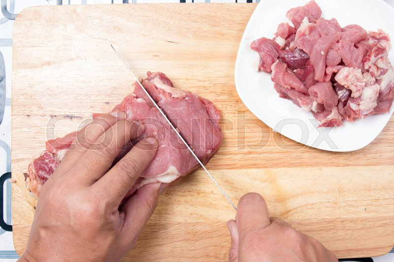 Stock image of 'Chef slicing beef before cooking / Cooking green curry concept'