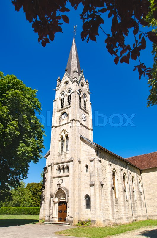 Editorial image of 'old rural church in france on a sunny day'