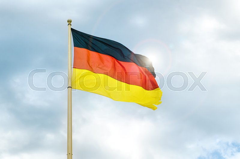 Stock image of 'german flag with sun and sky'