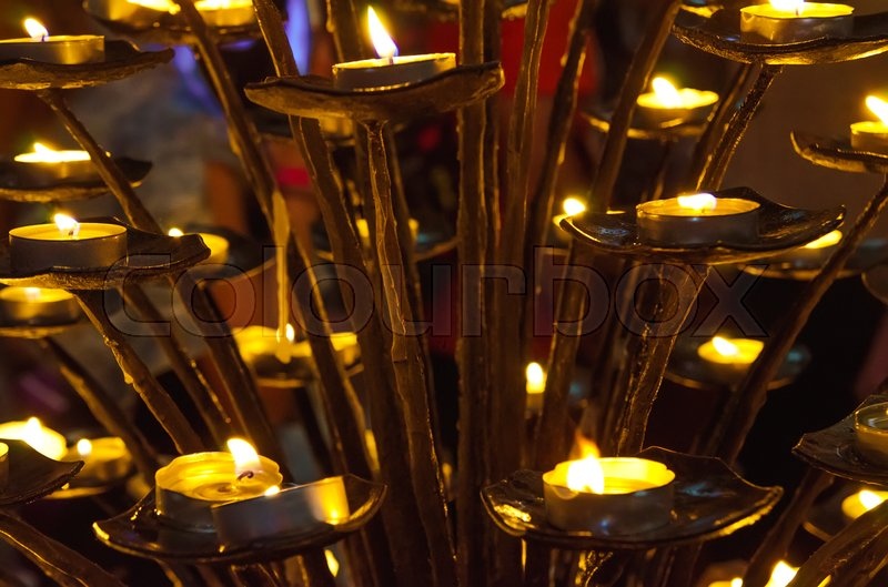 Stock image of 'a lot of candles in church'