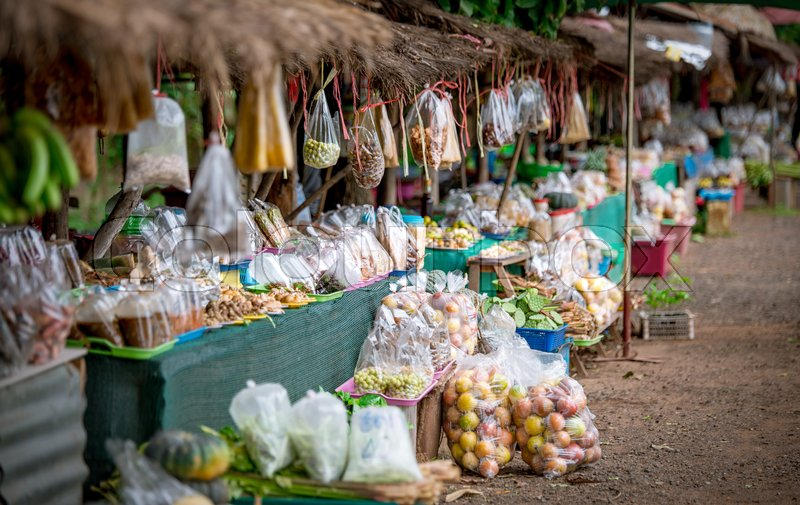 Stock image of 'Vegetables and fruit stall at roadside in Thailand'