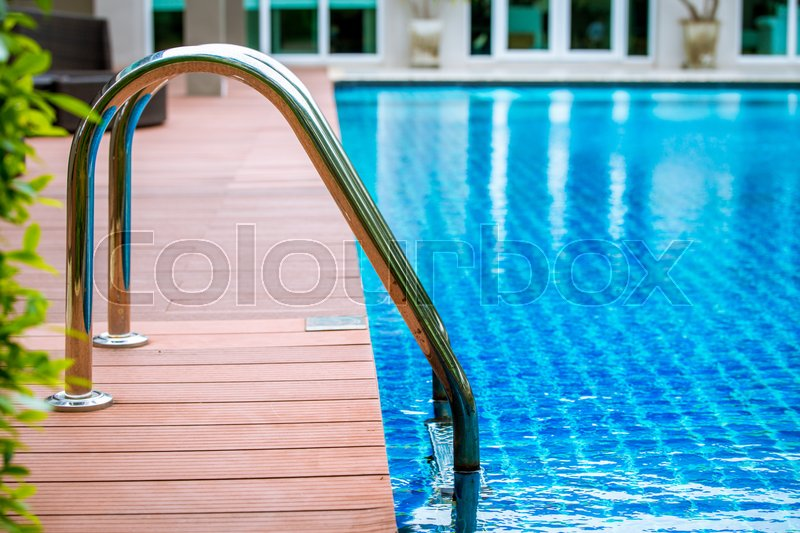 Stock image of 'swimming pool with stair on wood flooring'