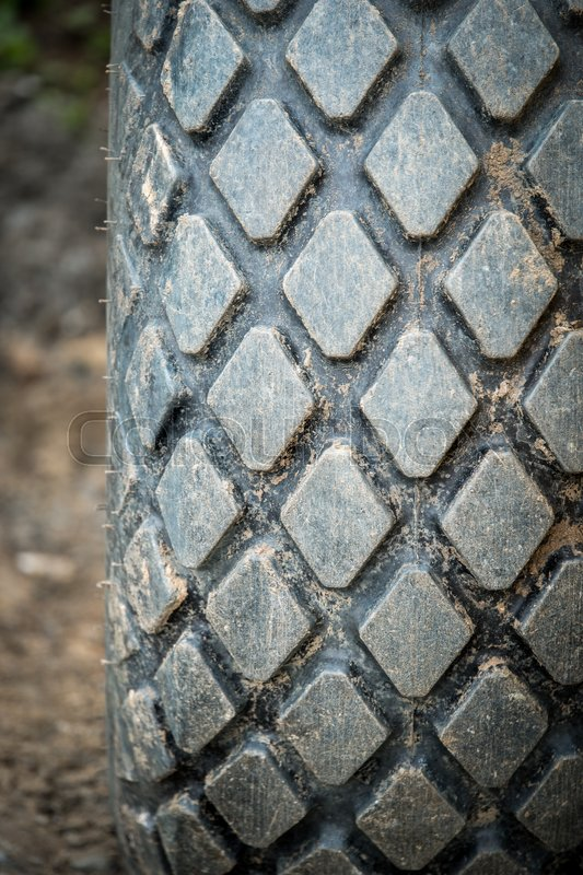 Stock image of 'Truck tire on soil road'