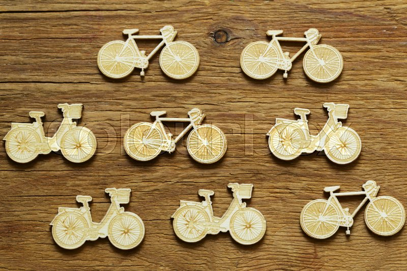 Stock image of 'Figures of a bicycle on a wooden background'