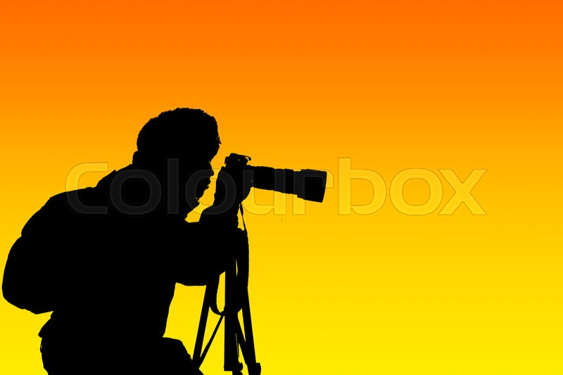 Stock image of 'Silhouette photographer with sunset background'