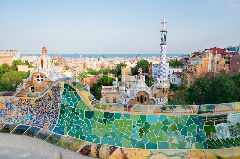 Editorial image of 'Gaudi bench and cityscape of Barcelona from park Guell, famous view of Barcelona, Spain'