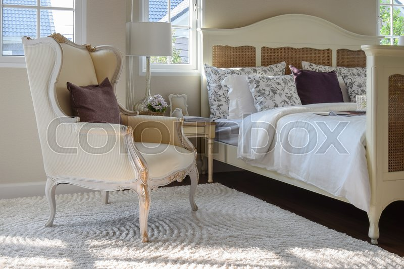 Stock image of 'Classic chair with brown pillow on carpet in vintage style bedroom interior'