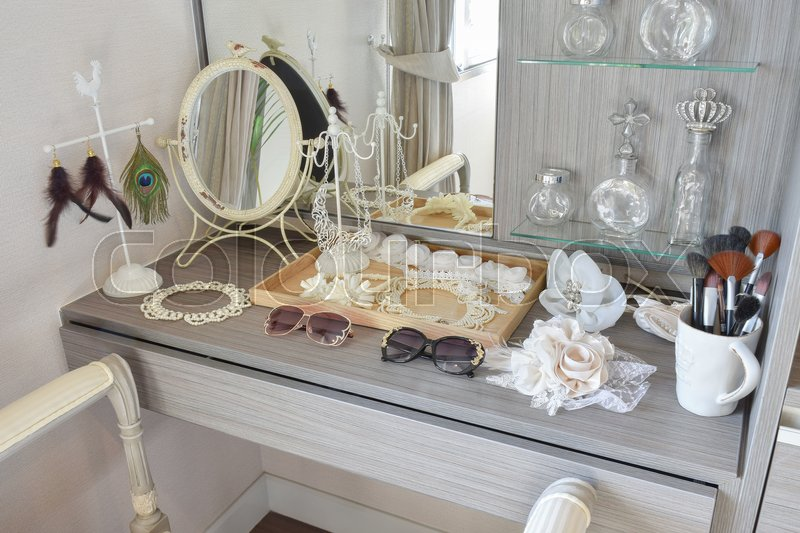 Stock image of 'Gray dressing table with accessories at home'