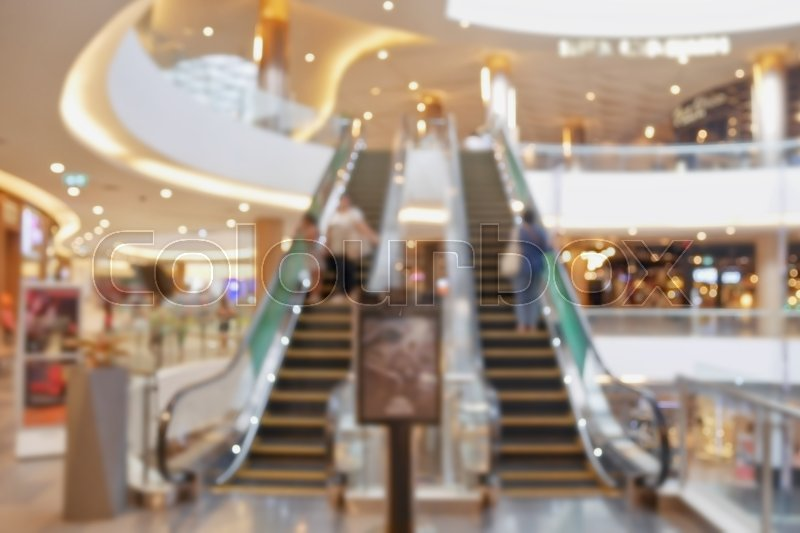 Stock image of 'Blurred escalator in department store'