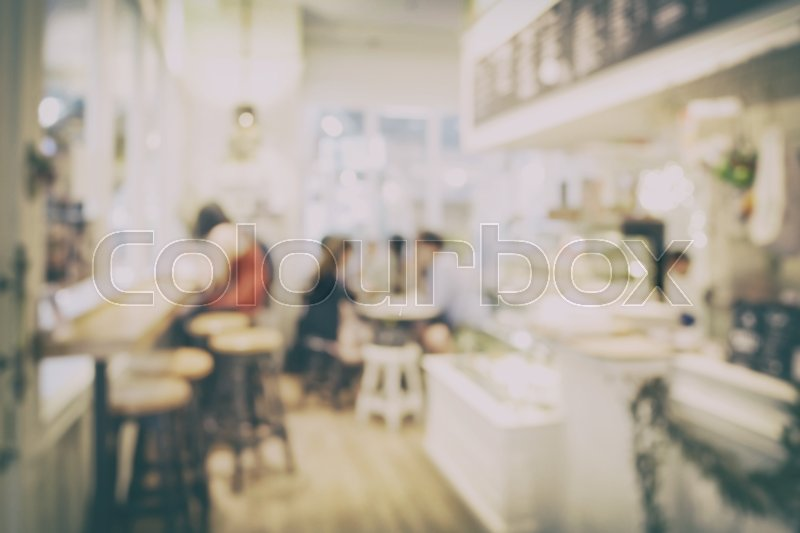 Stock image of 'Blur background interior of coffee shop with vintage style effect'