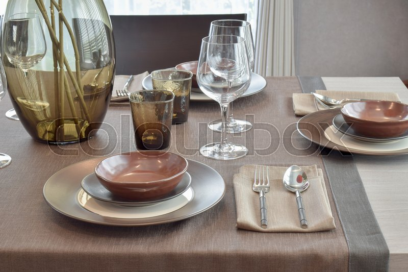 Stock image of 'Close up modern classic dining set o wooden dining table'