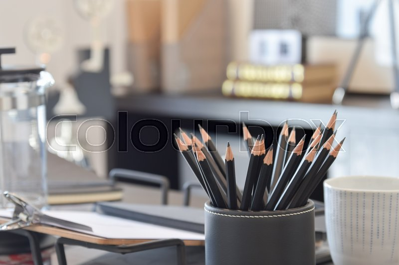 Stock image of 'Black pencils on working table at home'