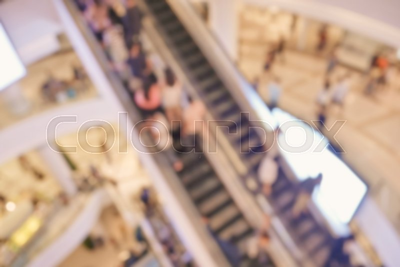Stock image of 'Blurred empty escalator in shopping mall'