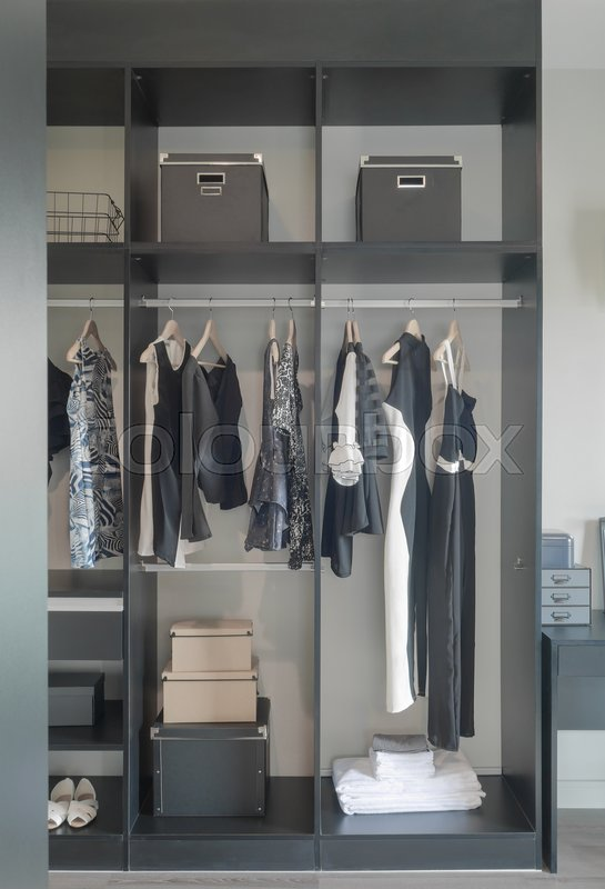Stock image of 'Dark color set up wardrobe for lady'