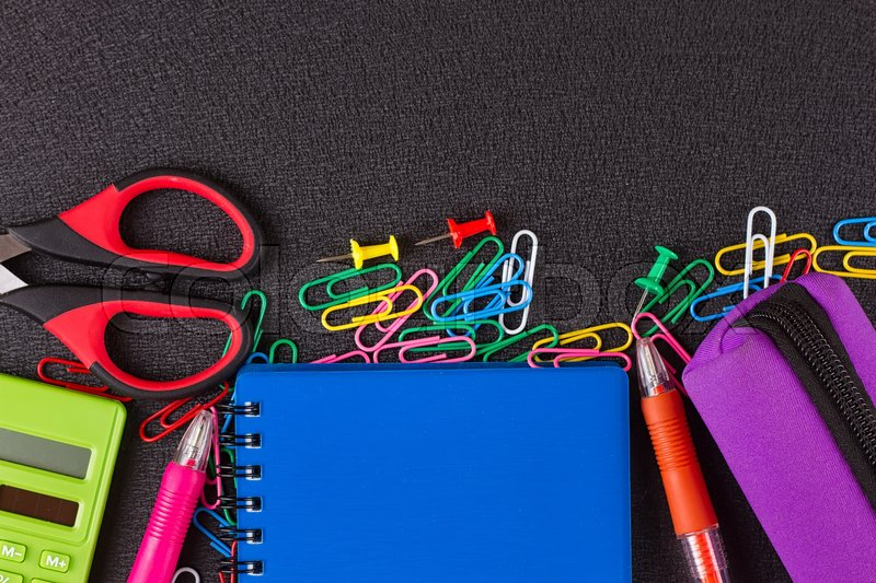 Stock image of 'School supplies on blackboard background ready for design'