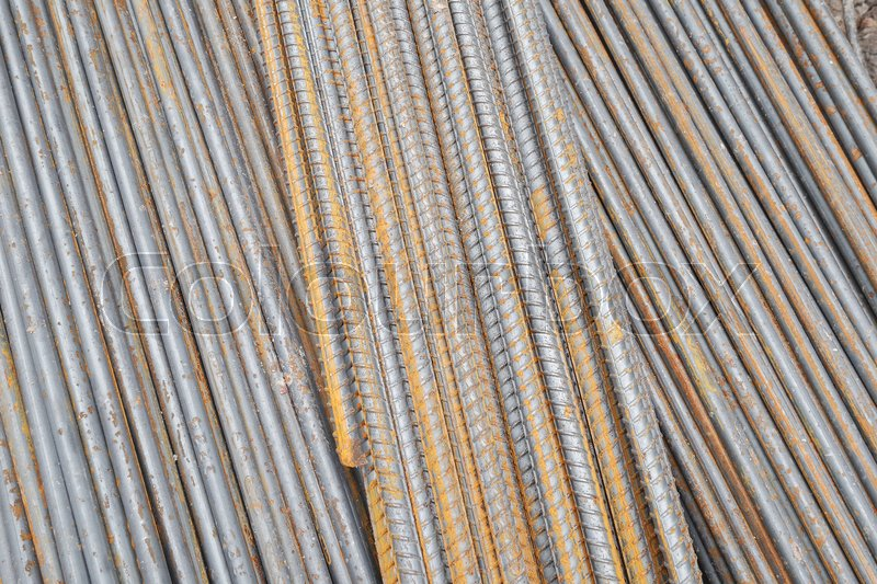 Stock image of 'Stack of rusty round steel bar - iron metal rail lines material for industry construction.'